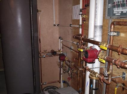 Irrigation backflow device and boiler feed cross connection control device installed on boiler system.