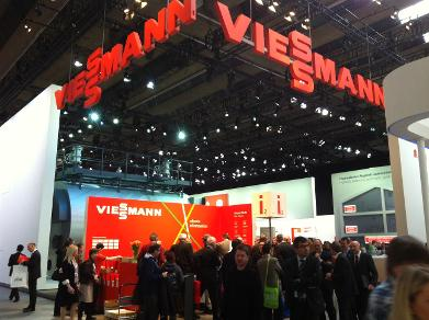 Bright orange Viessmann boiler display in Germany showing a interested customers