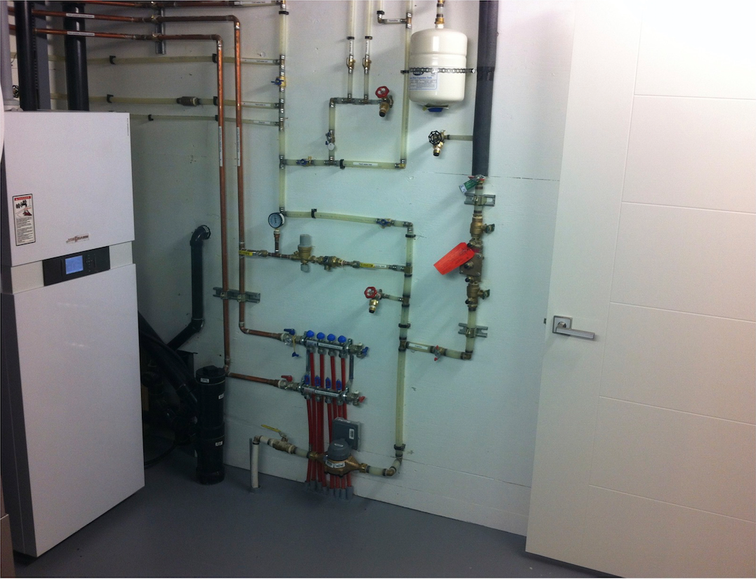Mechanical room with Viessmann boiler and irrigation cross connection control device